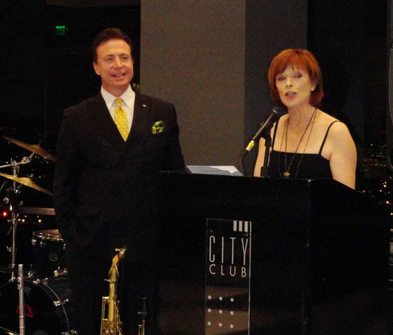 Frank Mottek MC-ing grand opening of new City Club with actress Frances Fisher.JPG