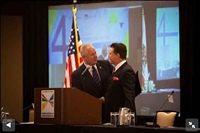 Frank Mottek welcomes LA City Councilman Tom Labonge to SCAG Economic Summit, 2013